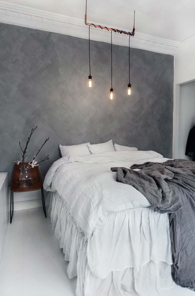 betonlook muur verf slaapkamer