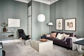 de olijfgroene muren in dit appartement zien er geweldig uit