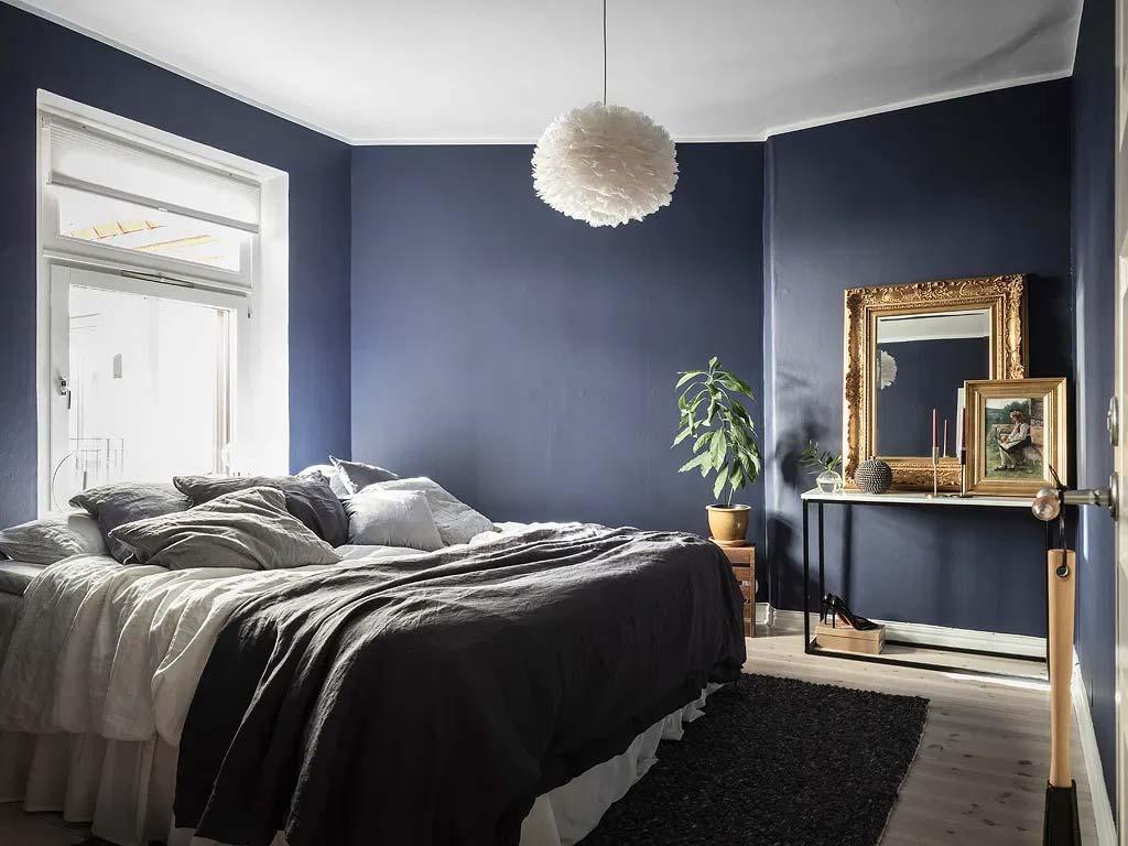 donkerblauwe muren slaapkamer