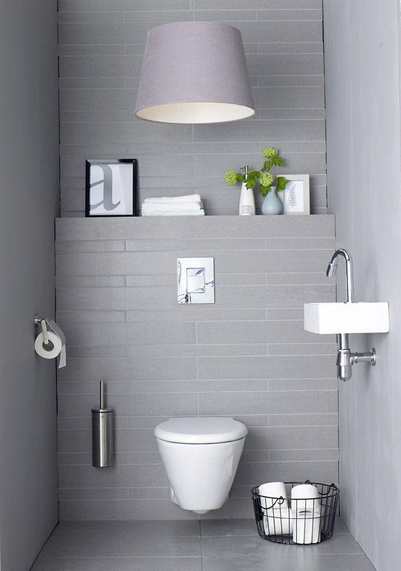 Grijze tegels in toilet