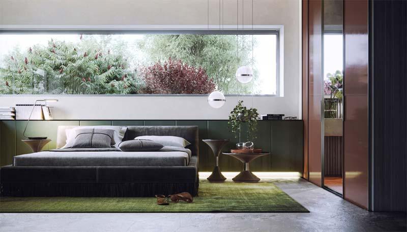 In deze strakke moderne slaapkamer heb je naast een prachtig uitzicht op de groene bomen ook een op maat gemaakte kast achter het bed en een groot groen vloerkleed.