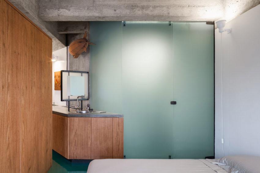 Klein open loft appartement met een groene vloer!