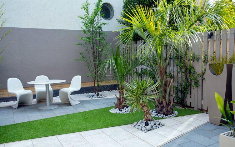 kleine tuin ontwerpen chique cosmopolitan tuin palmbomen