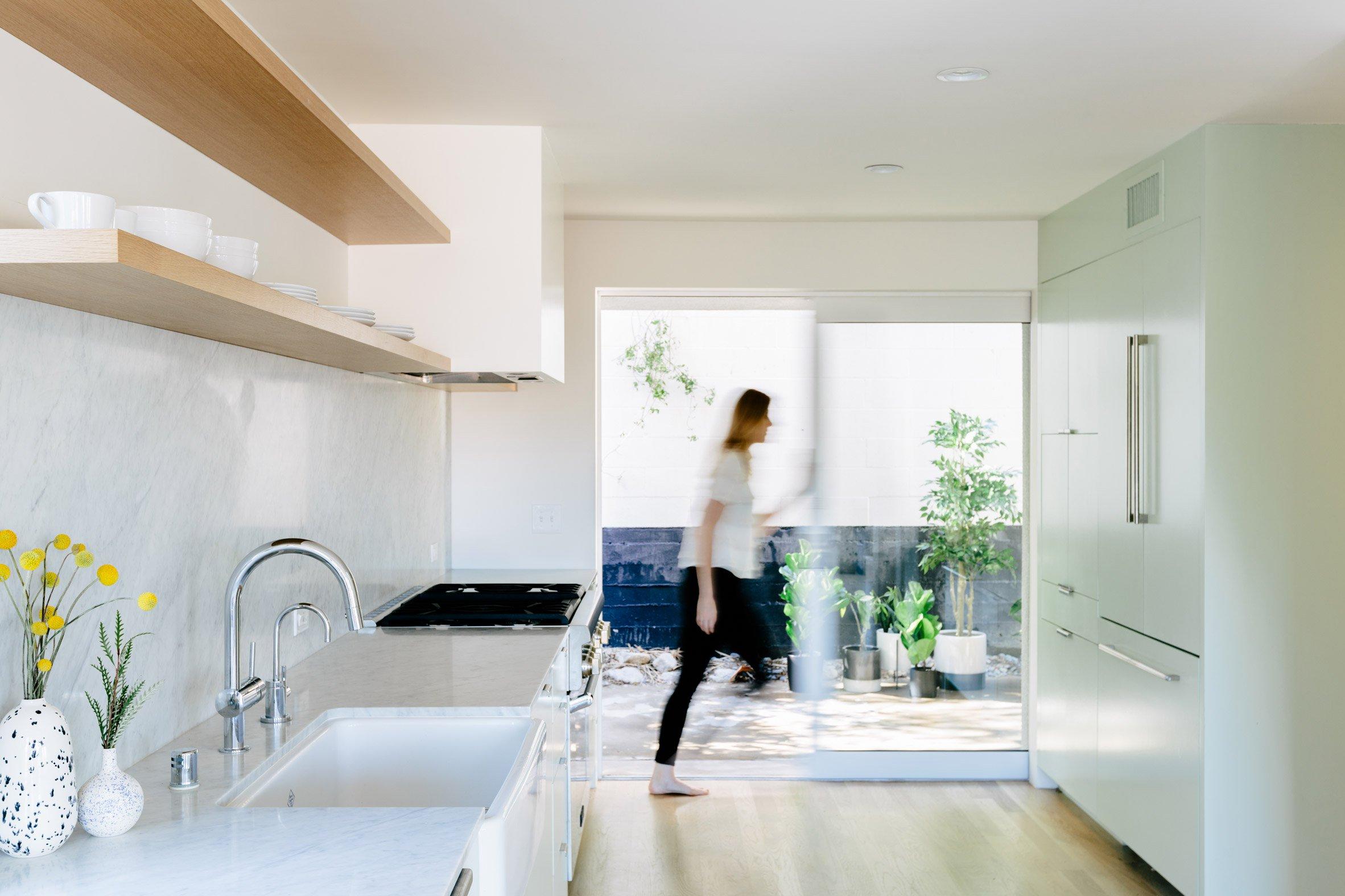 L vormige woonkamer met scandinavische eethoek en mintgroene
