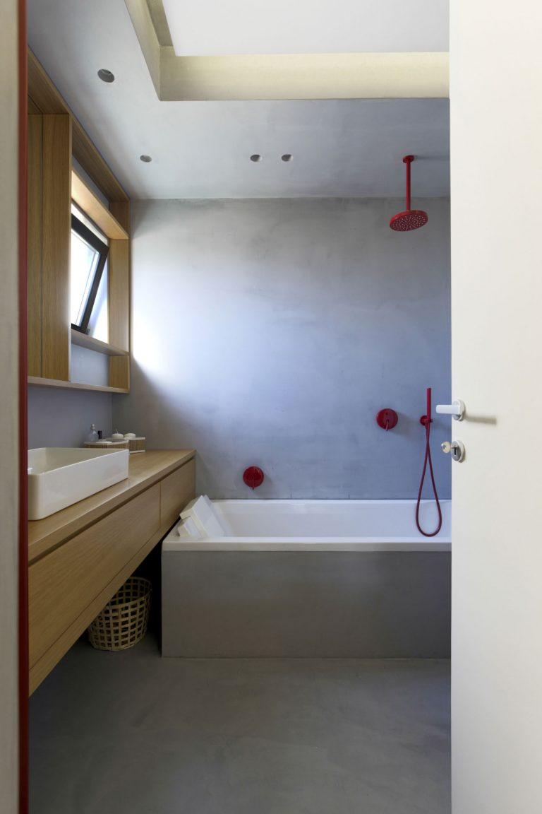 Moderne badkamer betonstuc muren