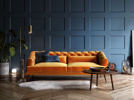 Oranje fluwelen chesterfield bank