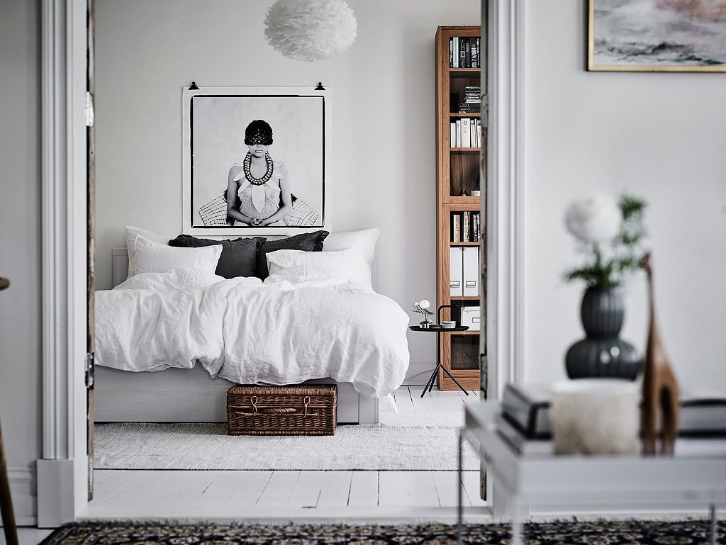 poster boven bed slaapkamer