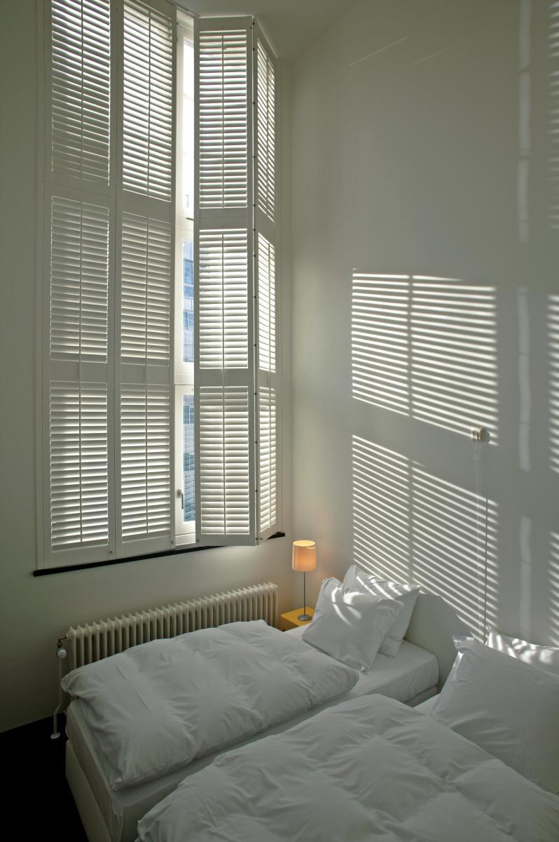 Shutters voor hoge ramen