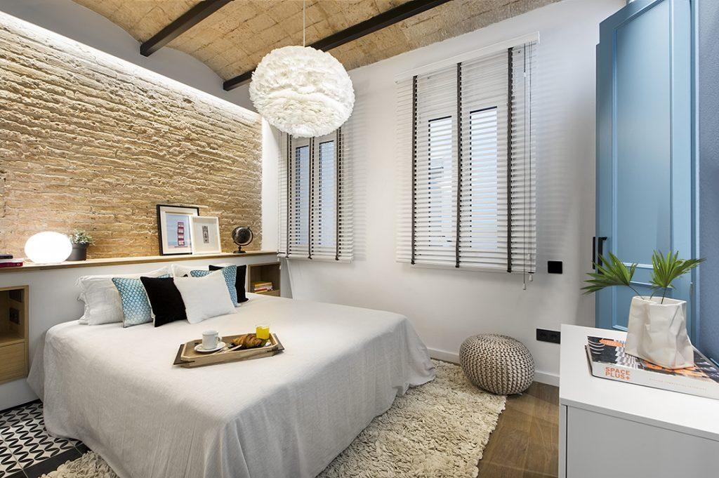 Slaapkamer in een stoer en stijlvol strand thema